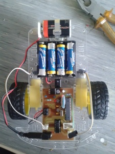Robot car with the e-bay skeleton and control board. Atmega168 is the big one on the right, L293D is the one on the bottom and HC-06 is the one that blinks..