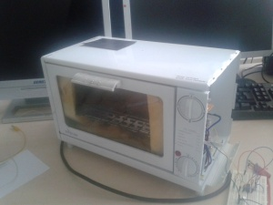Toaster oven that will do all the hard work in my reflow machine. Wire on the side are for testing and sponge inside is actually a glass-wool isolation.